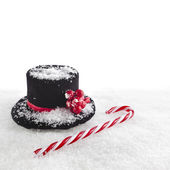 Black top hat snowman with Cane, christmas card isolated on white snow background — Stock Photo
