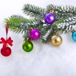 Christmas snow background with colorful balls and fir branch, copy space for your text — Stock Photo