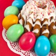 easter bread cake and colored egg on red background — Stock Photo
