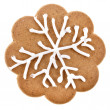 Christmas gingerbread cookies surface top view close up macro shot with snowflakes isolated on a white background — ストック写真