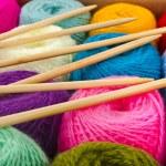 Multi-colored balls of wool knitting yarn in a cardboard box close up — Stock Photo