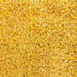 Golden glitter background texture closeup — ストック写真
