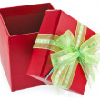 Holiday gift red box with green bow. Isolated on white background — Stock Photo