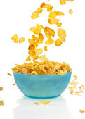 Flying to the bowl corn flakes isolated on white background — Stock Photo