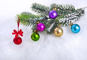 Christmas snow background with colorful balls and fir branch, copy space for your text — 图库照片