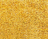 Golden glitter background texture closeup — Stock Photo