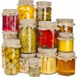 Collection tower of many glass bottles with preserved food — Stock Photo #34310611