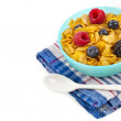 Corn flakes with fresh berries in dish  — Stock Photo