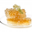 Sweet linden honey in the tea saucer — Stock Photo