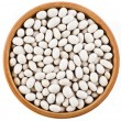 White peas beans in wooden bowl dish top view close up  — Foto Stock