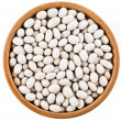 White peas beans in wooden bowl dish top view close up  — Стоковая фотография