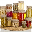 Collection tower of many glass bottles with preserved food — Stock Photo