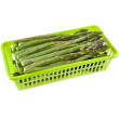 Asparagus heap in green plastic container  — Stock Photo