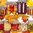 Collection of many glass bottles with homemade preserved food and autumnal colored leaves — Stock Photo