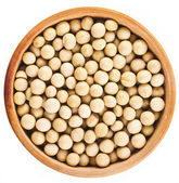 Soybeans over wooden bowl dish top view surface close up — Stock Photo