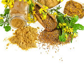 Mustard jar and mustard powder spoon, seeds scoop, with fresh mustard flower — Foto de Stock