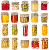 Collection set of many homemade glass bottles with preserved food close up — Stock Photo