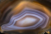 Agate crystal with concentric layers surface background — Stock Photo