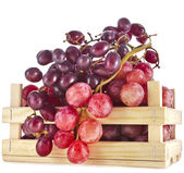 Colorful mixed grapes in a wooden crate box — Stock Photo