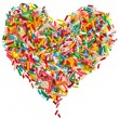 Colorful candy sprinkles heart shape isolated on white background — Stock Photo
