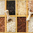 Assortment of rice in wooden case box with scoop surface top view — Stock Photo