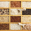 Stock Photo: Assortment of rice in wooden box surface top view