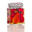 Preserved red hot pepper with reflection in glass jar close up isolated on a white background — Стоковая фотография