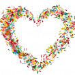 Heart shaped frame card made from colored sprinkles close up isolated on white background — Stock Photo #36635715