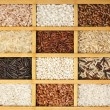 Assortment of rice in wooden box surface top view — Stock Photo