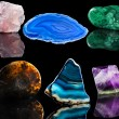 Collection set of mineral stone close up with reflection on black surface background — Stock Photo #36635915