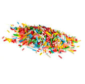 Colorful candy sprinkles heap close up isolated on white background — Stock Photo