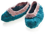 Homemade knitted woolen slippers shoes isolated on white background — Stock Photo