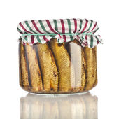 Sardines fishes with oil conserved in glass jar close up isolated on the white background — Stock Photo