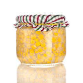Canned corn in a glass jar pot isolated on white background — Stock Photo
