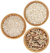 Assortment of rice in wooden dish top view surface close up isolated on white background — Stock Photo