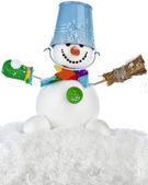 Funny snowman with blue bucket and broom in hand , sitting on a snowdrift isolated on white background — Stock Photo