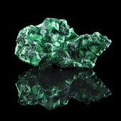 Malachite mineral stone close up with reflection on black surface background — Stock Photo