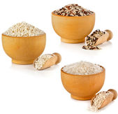 Assortment set of rice in wooden dish and scoop isolated on white background — Stock Photo