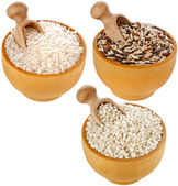 Assortment of rice in wooden dish and scoop isolated on white background — Stock Photo