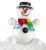 Funny snowman with black hat sitting in a snowdrift isolated on white background — Stock Photo