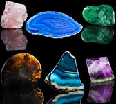 Collection set of mineral stone close up with reflection on black surface background — Stock Photo