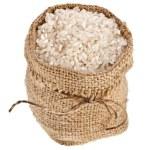 Basmati rice in small burlap sack isolated on white background — Stock Photo #38075311