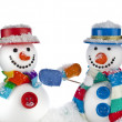 Cheerful snowmans in a striped scarfs, mittens and cylinder hat isolated on white background — Stock Photo