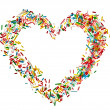 Heart shaped frame card made from colored sprinkles close up isolated on white background — Stock Photo #38075685