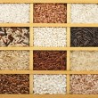 Variety of rice grains (white, brown, black, wild, basmati, arborio, short, long grain) in vintage wooden case box — Stock Photo #38075903