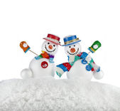 Two fun dancing snowmans in a striped scarfs, mittens and cylinder hat isolated on white background — Stock Photo