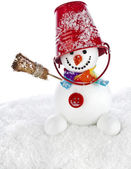 Cheerful snowman with red color bucket on his head and broom in hand isolated on white background — Stock Photo