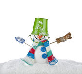 Cheerful snowman with green color bucket on his head and broom in hand isolated on white background — Stock Photo