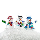 Three Cheerful snowmans in a striped scarfs, mittens and cylindder hat isolated on white background — Stock Photo