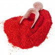 Powder paprika with wooden spoon — Stock Photo